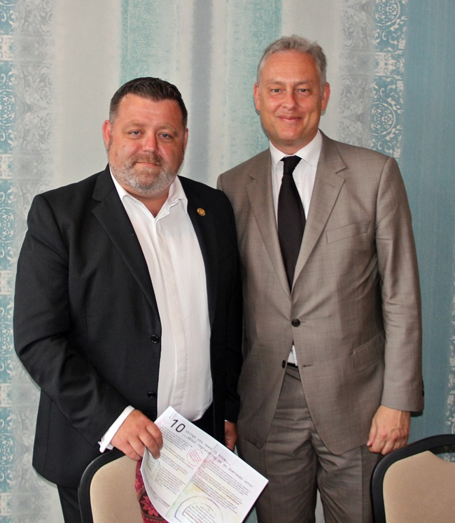 Councillor Dean Shelton with Ambassador Simon Manley